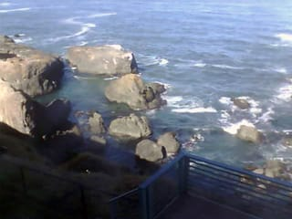 Hotel room view at Inn of the Lost Coast looking down Shelter Cove shorline and rock formations in front of hotel - thumbnail  Shelter Cove Sunset Cam webcam hotel room view