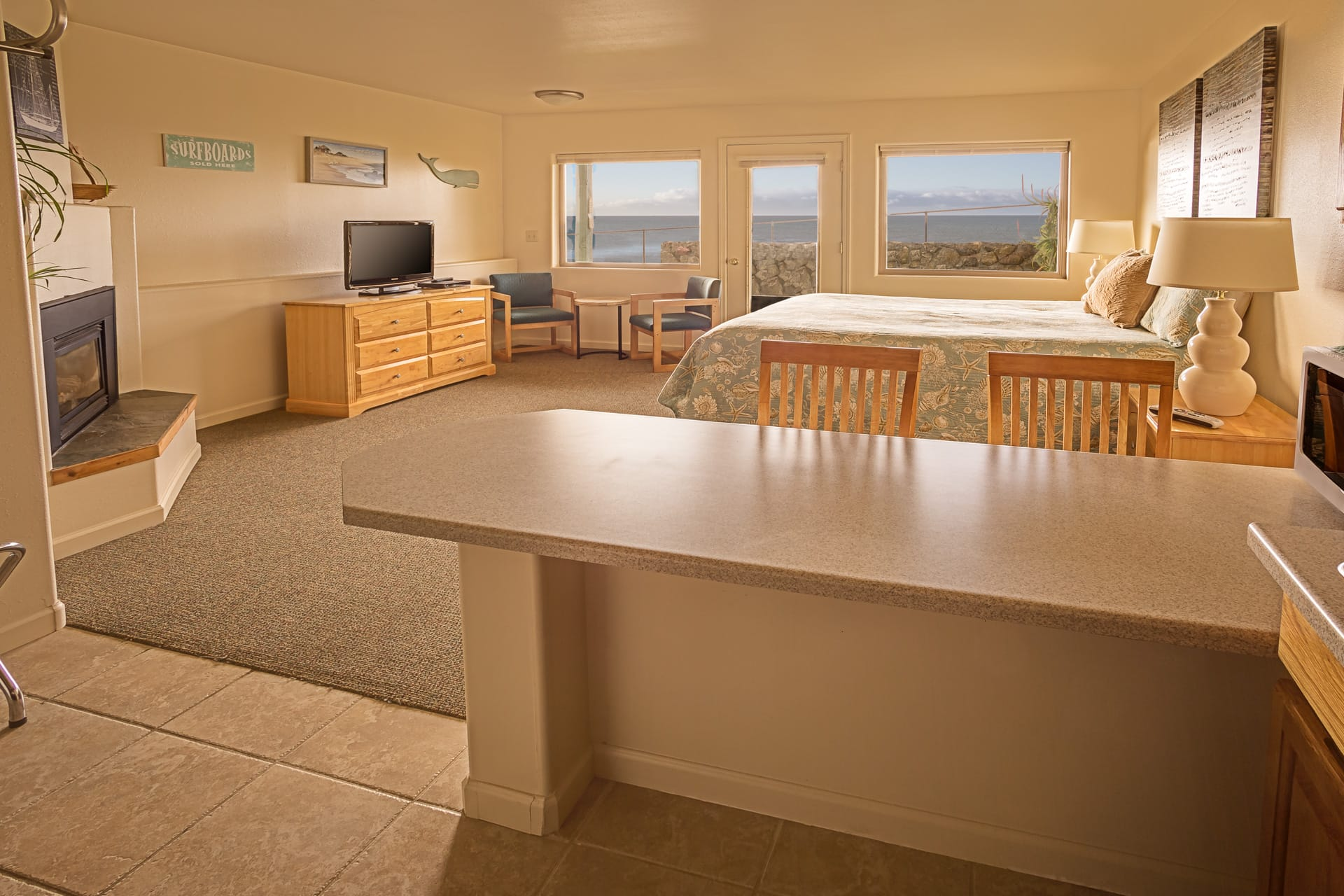 Extended stay oceanfront Kitchen Suite hotel room at Inn of the Lost Coast Shelter Cove, with King size bed, fireplace, HDTV flatscreen, and patio with panoramic view of Northern California Pacific Ocean coastline.