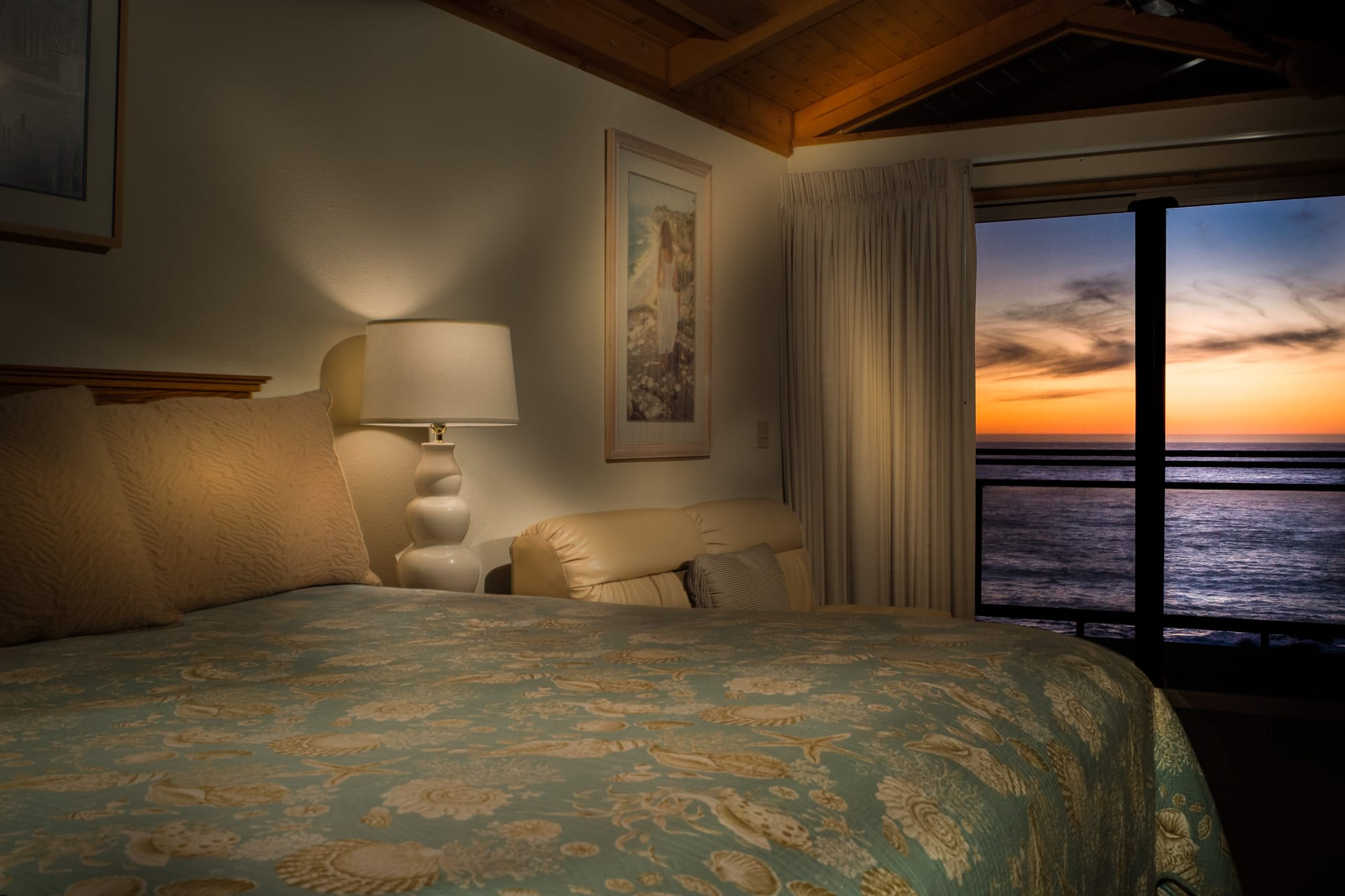 Sunset at Inn of the Lost Coast Shelter Cove from King size bed in this Deluxe Spa Suite hotel room.