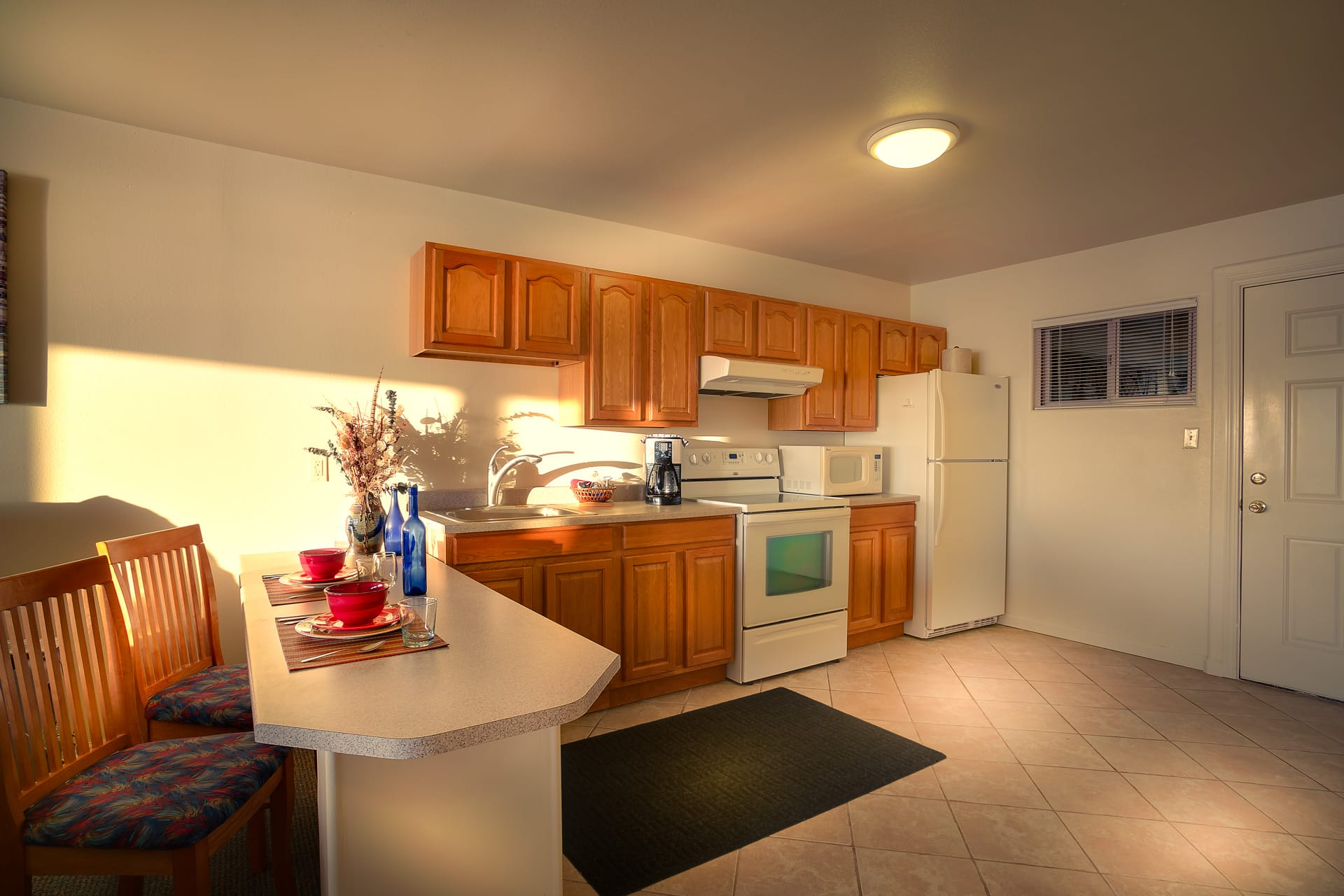 Luxury Kitchen Suite Hotel Room With Full Size Kitchen Appliances, Wood  Cabinets, And
