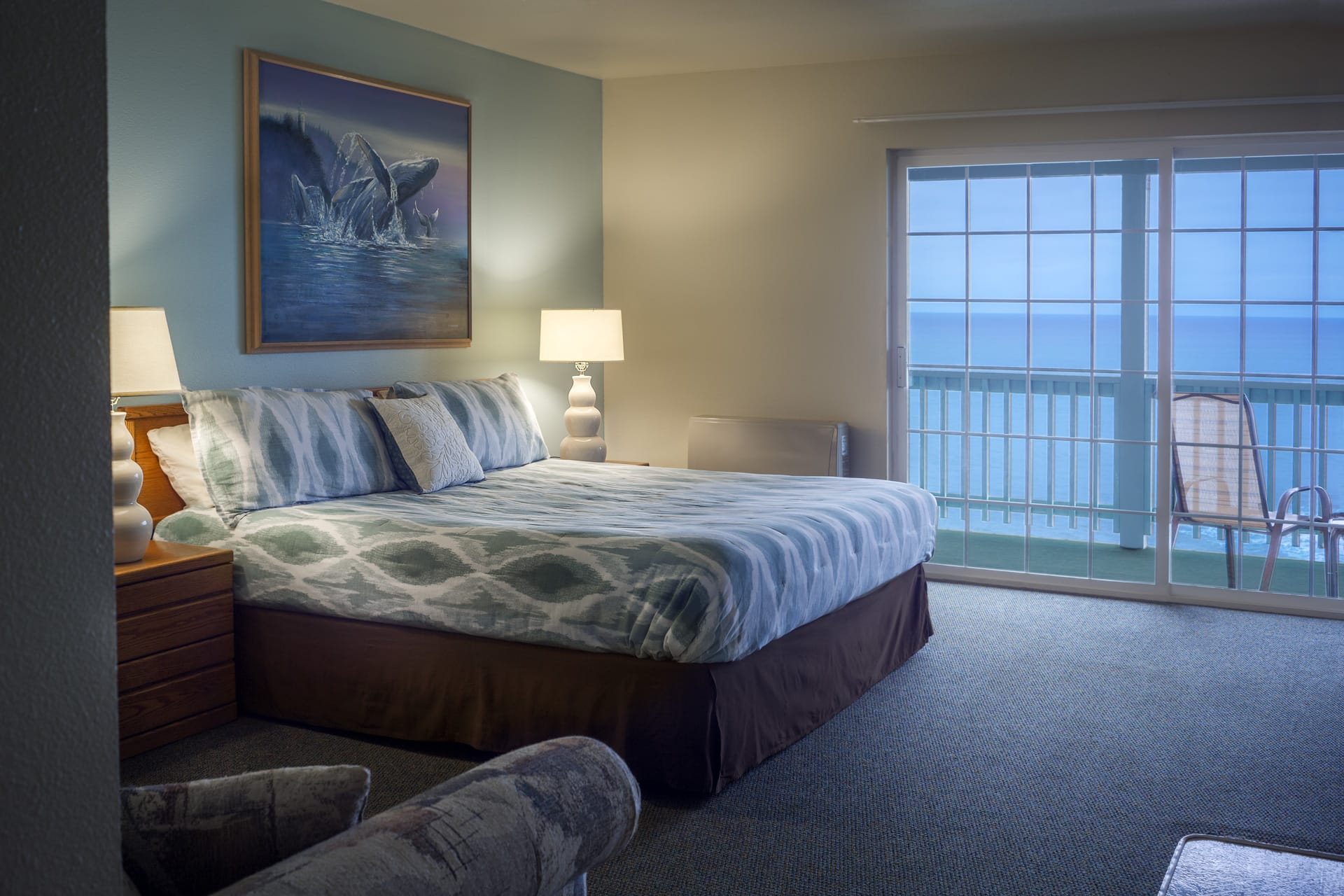 Standard Guestroom hotel room at the oceanfront Inn of the Lost Coast Shelter Cove with King size bed and private balcony overlooking the Pacific Ocean's Northern coastline.